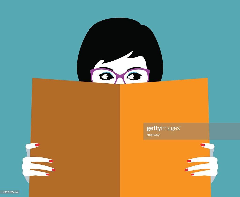 Beautiful girl face behind big book