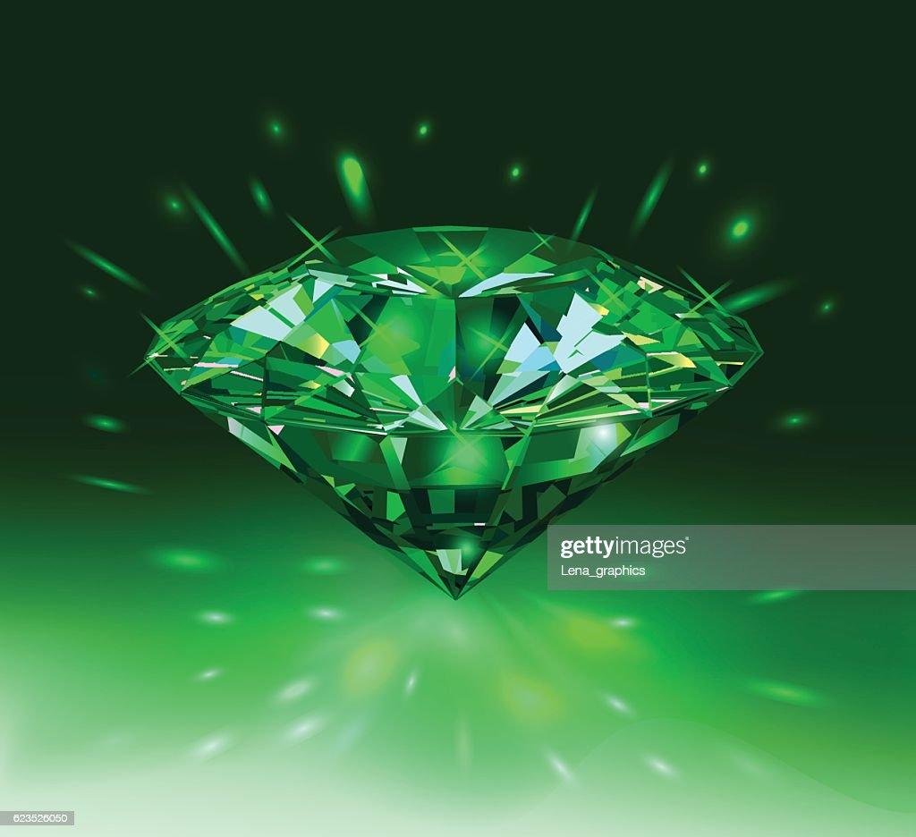 Beautiful green gem emerald on light green background.