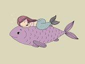 Beautiful little mermaid and big fish.