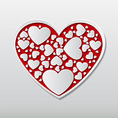 beautiful red paper cuts the heart with white frame and many small white heart images surround in the heart frame.Vector illustration