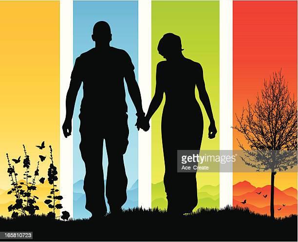 美しい手をロマンチックなカップルのシルエット
