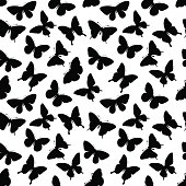 Beautiful seamless background with butterflies silhouettes.