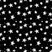 beautiful seamless pattern hand drawn doodle stars black and white isolated on background. night sky