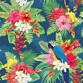 Beautiful seamless pattern with hibiscus flowers and macaw on dark blue background.