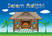 "A beautiful traditional wooden Malay style village house. With village scene. The words ""Salam Aidilfitri"" means happy Hari Raya"