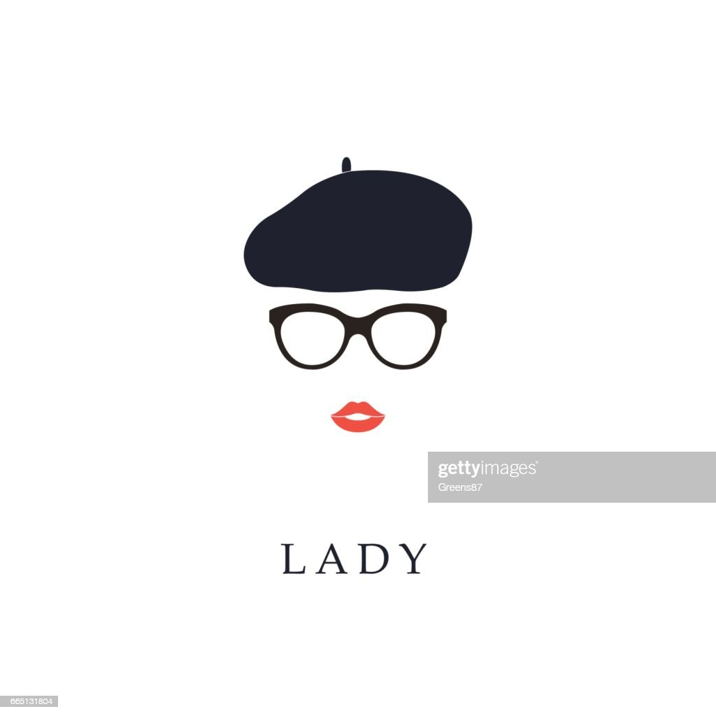 Beautiful trendy French woman wearing glasses and beret.