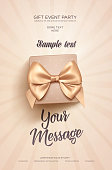 Beautiful Valentine's Day greeting flyer or poster. Top view on beige gift box and golden bow.