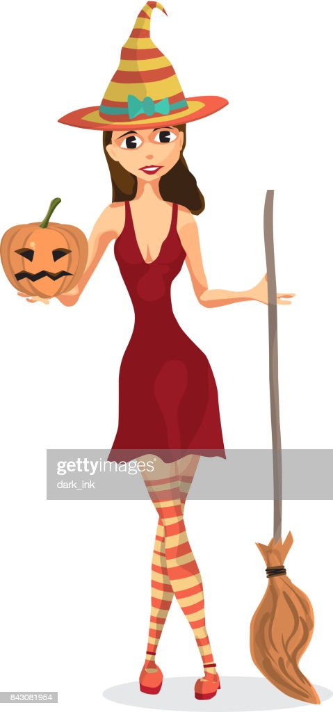 Beautiful witch in a red dress holding a pumpkin