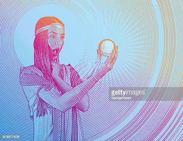 Beautiful woman fortune teller with shocked expression holding crystal ball