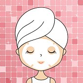 Beautiful woman in bathroom with head towel making cosmetic procedures