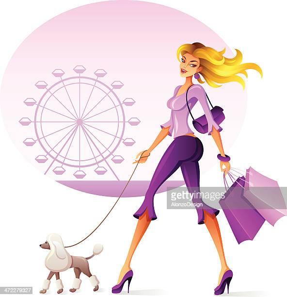 Beautiful woman walking her dog.