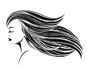 Beautiful woman with long, wavy hair and elegant makeup