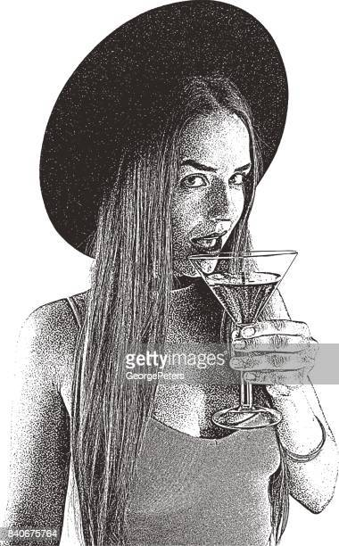 Beautiful young woman clubbing and drinking a cocktail