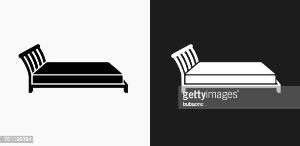 bed icon on black and white vector backgrounds - mattress stock illustrations, clip art, cartoons, & icons