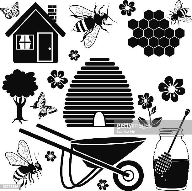 beehive and garden icon set in black and white