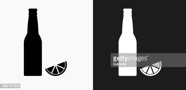 Beer Bottle and Lime Icon on Black and White Vector Backgrounds