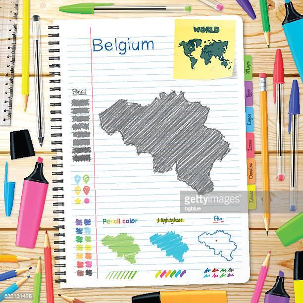 Belgium maps hand drawn on notebook. Wooden Background