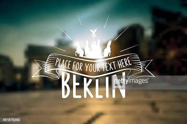 Berlin vintage sign on blurred  sunset city background