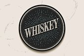Beverage coaster with inscription Whiskey and light rays