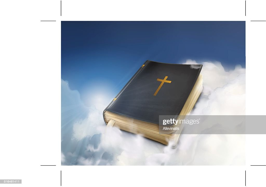 Bible, old book in the clouds
