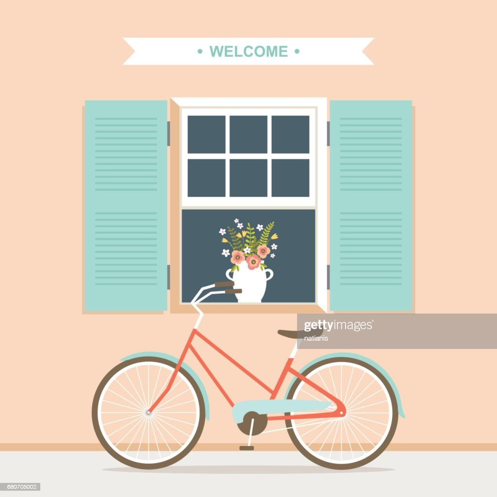 Bicycle under the opened window