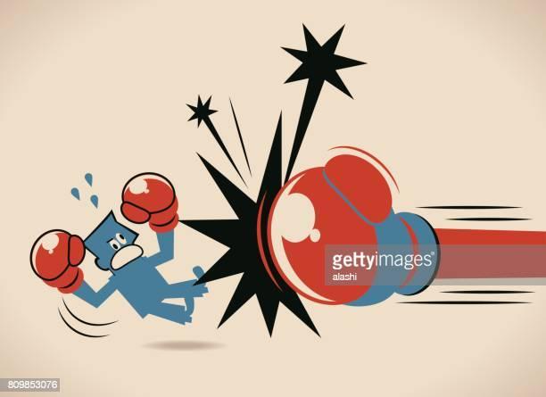 ilustrações de stock, clip art, desenhos animados e ícones de big boxing glove punching (hitting) a businessman (man) - luva de boxe