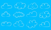 Big collection of hand drawn white clouds on blue background. Vector.