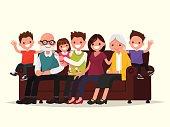 Big family sitting on the sofa. Grandfather, grandmother, father