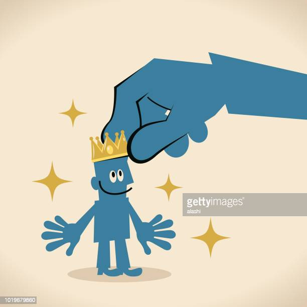 Big hand places a gold crown on a smiling businessman's head