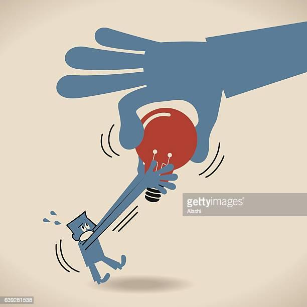 Big hand robbing (seizing; stealing) an idea light bulb