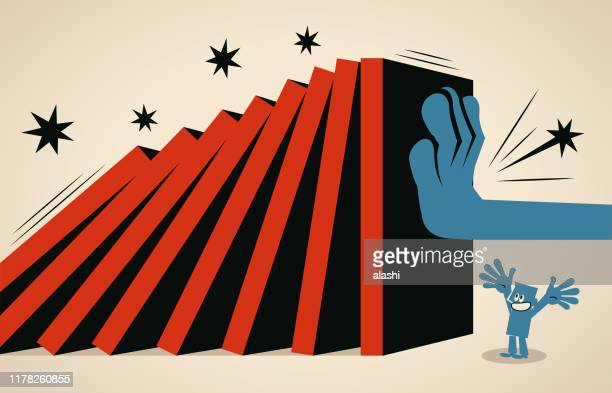 big hand stopping domino effect to protect a businessman - domino effect stock illustrations