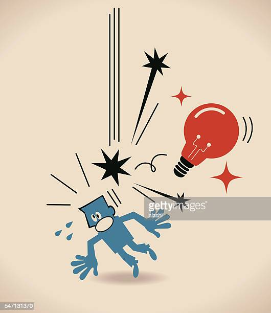 Big idea light bulb falling and hitting businessman (designer, author)