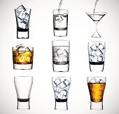Big set of drinking glass with ice water and alcohol