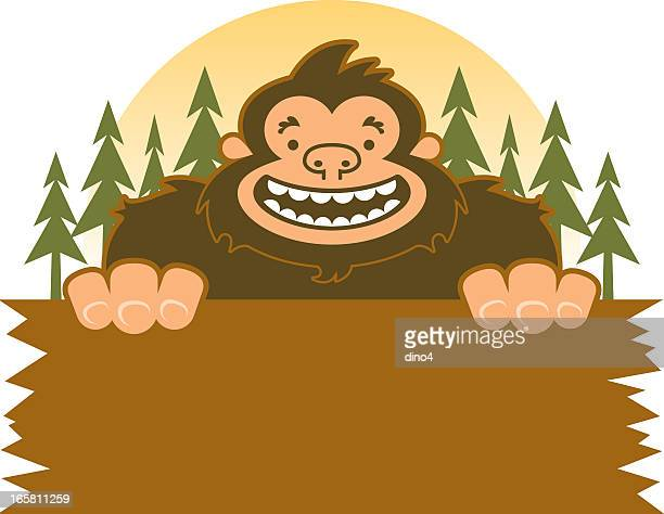 bigfoot smiling holding sign in the woods - bigfoot stock illustrations