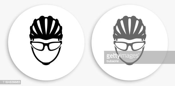 bike helmet black and white round icon - cycling helmet stock illustrations