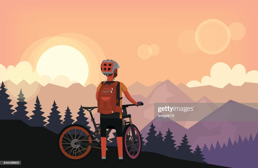 Bike rider watching sunset