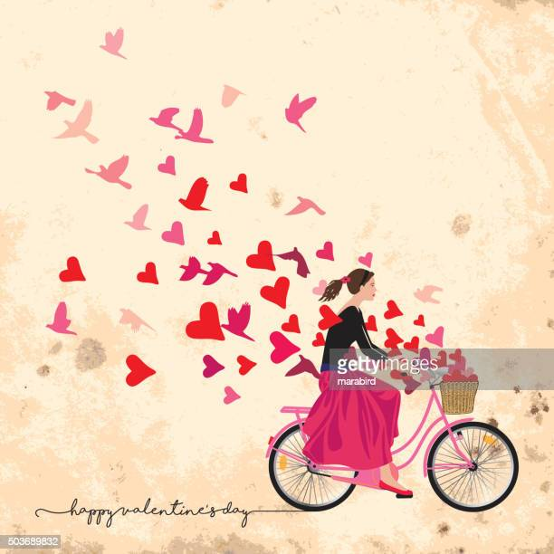 bike-riding girl sends feelings of love and freedom - paperboard stock illustrations