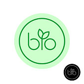 Bio text symbol with green leaves on letter I. Natural product concept round badge.