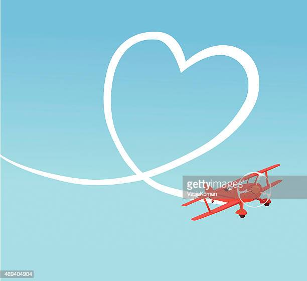 biplane creating heart shape on the sky - vapor trail stock illustrations, clip art, cartoons, & icons