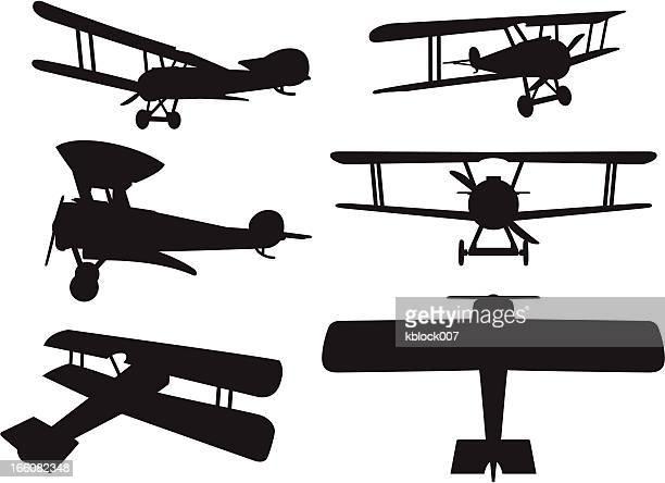 biplane silhouettes - biplane stock illustrations, clip art, cartoons, & icons