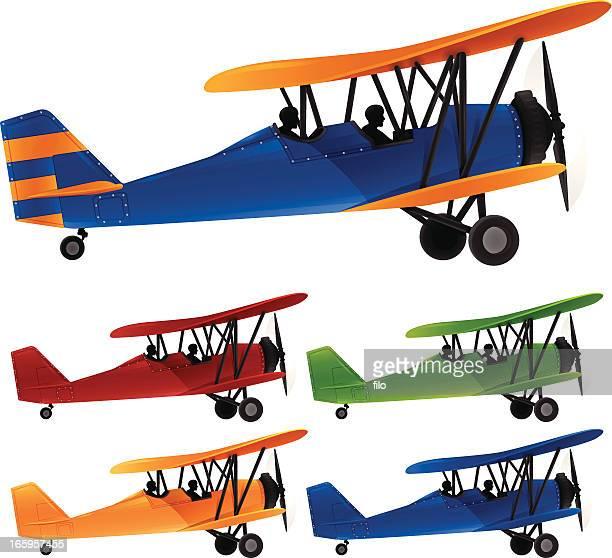 biplane - biplane stock illustrations, clip art, cartoons, & icons