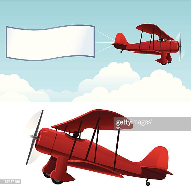 biplane with banner - biplane stock illustrations, clip art, cartoons, & icons
