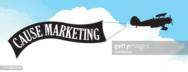 bi-plane with cause marketing banner - holding up sign stock illustrations