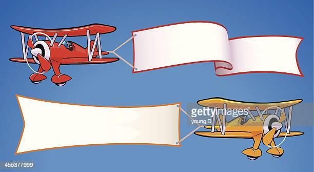 bi-planes & banners - biplane stock illustrations, clip art, cartoons, & icons