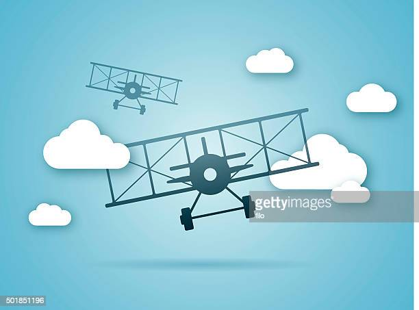 Biplanes Flying in the Clouds