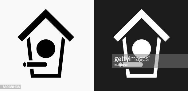 Bird House Icon on Black and White Vector Backgrounds