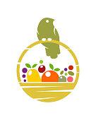 Bird on harvest basket with fruit and vegetables