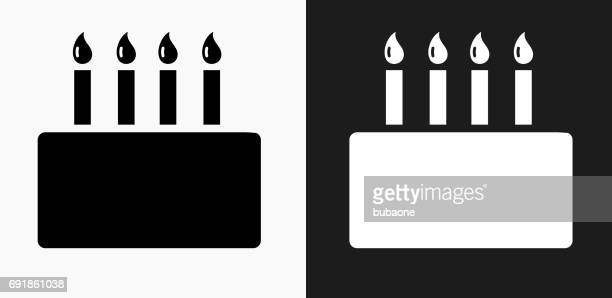 birthday cake icon on black and white vector backgrounds - cake stock illustrations, clip art, cartoons, & icons