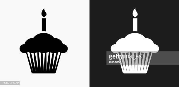 birthday cupcake icon on black and white vector backgrounds - candle stock illustrations, clip art, cartoons, & icons