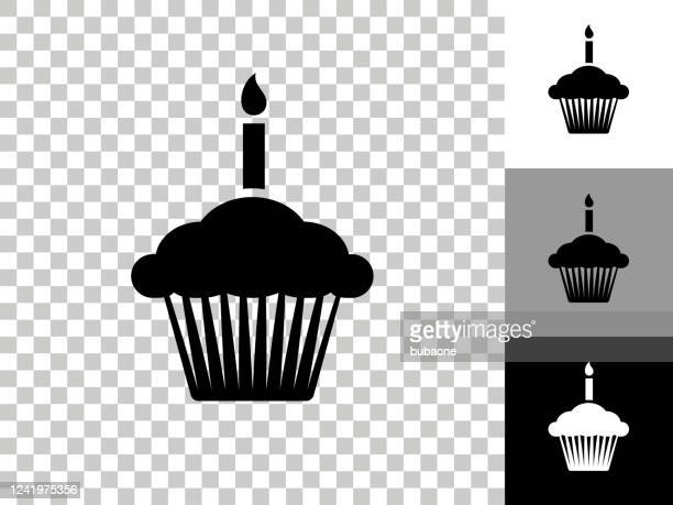 birthday cupcake icon on checkerboard transparent background - birthday candle stock illustrations